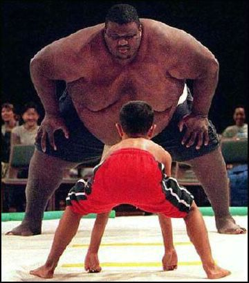 Sumo wrestler and boy